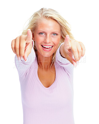 Buy stock photo Portrait of a happy young female pointing towards camera isolated on white