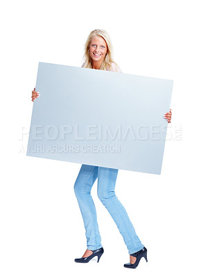 Buy stock photo Full length of a cute young female holding a blank bill board isolated on white