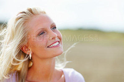Buy stock photo Lovely young female looking away smiling, farm view in the background