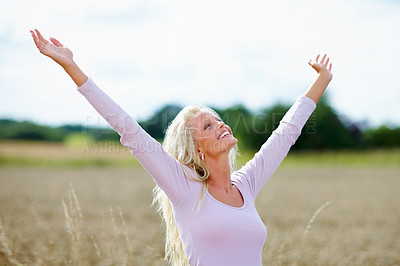 Buy stock photo Lovely young woman enjoying the freedom of an open crop field