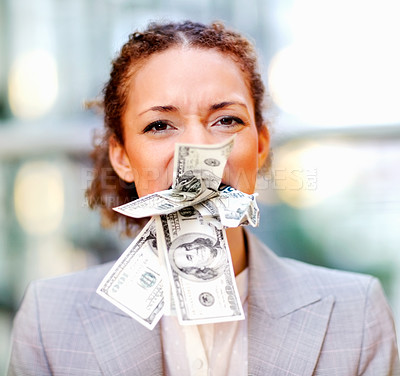 Buy stock photo Angry African American business woman with money stuffed in her mouth