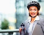 Cute young business woman wearing a cycling helmet to work