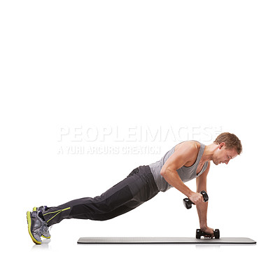 Buy stock photo A fit young man performing the row exercise with dumbbells on a mat
