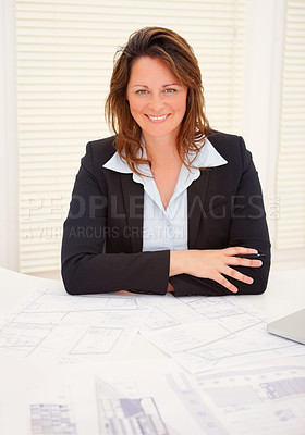 Buy stock photo Portrait of a successful happy mature business woman sitting at her desk