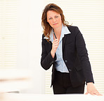 Business woman holding a pen in the office
