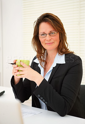 Buy stock photo Portrait of a middle aged business woman having a cup of coffee at work