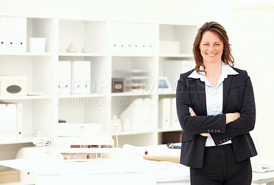 Buy stock photo Happy confident executive female architect with her building design