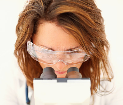 Buy stock photo Closeup portrait of a medical laboratory woman researching on a microscope