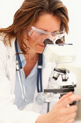 Buy stock photo Successful medical woman researching on a microscope