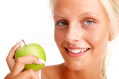 Buy stock photo Pretty young female holding a green apple over white background
