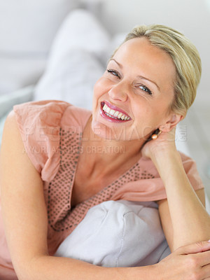 Buy stock photo Lovely middle aged woman smiling while at home