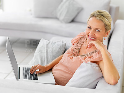 Buy stock photo Portrait of a mature business woman working on t he laptop from home