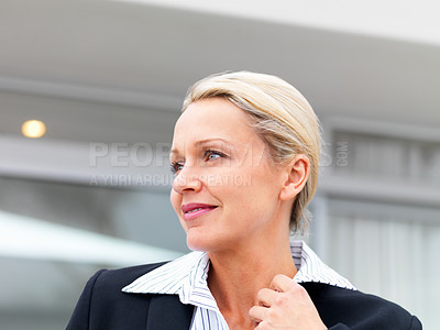 Buy stock photo A pleasant middle age business woman smiling while looking away