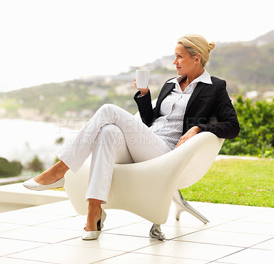 Buy stock photo Successful mature business woman enjoying a cup of coffee, outdoors