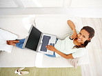 An African American woman using laptop in the living room