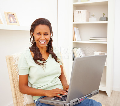 Buy stock photo African American young woman using a laptop at home