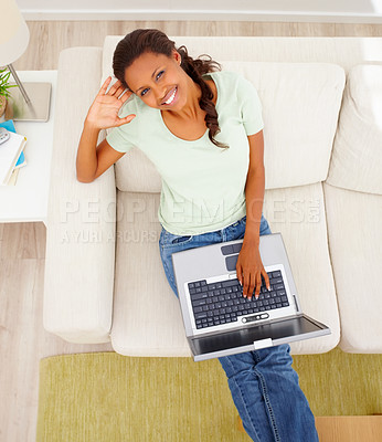 Buy stock photo Top view of an African American woman on sofa using a laptop
