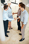 Happy executives shaking hands - Business meeting