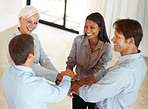 Symbol of unity and teamwork - Businesspeople with theirs hands