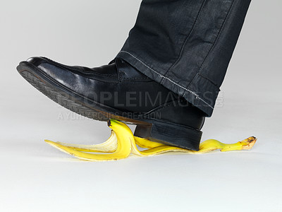 Buy stock photo Closeup portrait of a business man leg stepping on banana peel