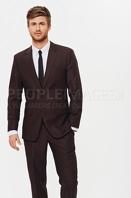 Buy stock photo Studio portrait of a stylish young man dressed in a suit and looking at the camera