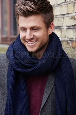 Buy stock photo Portrait of a stylishly-dressed young man standing in the street and smiling