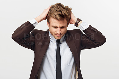 Buy stock photo Studio shot of a well-dressed young man running his hands through his hair