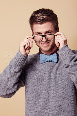 Buy stock photo Studio portrait of a stylishly-dressed young man wearing glasses and smiling at the camera