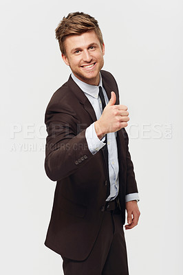 Buy stock photo Studio portrait of a stylishly-dressed young businessman giving a thumbs up to the camera