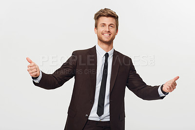 Buy stock photo Studio portrait of a stylishly-dressed young businessman giving two thumbs up to the camera