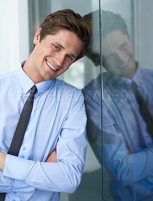 Buy stock photo A handsome young businessman crossing his arms and smiling at you