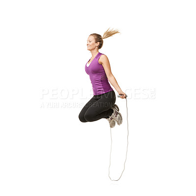 Buy stock photo An attractive young woman skipping with a smile on her face