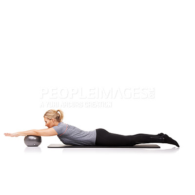 Buy stock photo A young woman using an exercise ball while lying down - isolated