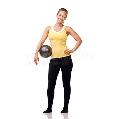 Buy stock photo A gorgeous young blonde holding an exercise ball after an invigorating workout