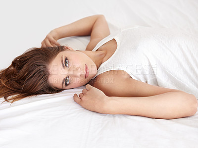 Buy stock photo A gorgeous young woman lying on her bed in a sleepshirt