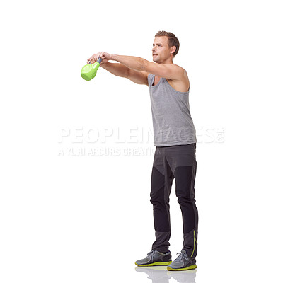 Buy stock photo A handsome young man working out with a kettlebell while isolated on a white background