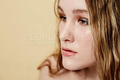 Buy stock photo An attractive young woman looking pensive