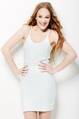 Buy stock photo Smiling young woman posing against a white background