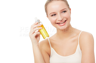 Buy stock photo A pretty young woman holding a bottle of perfume while isolated on a white background