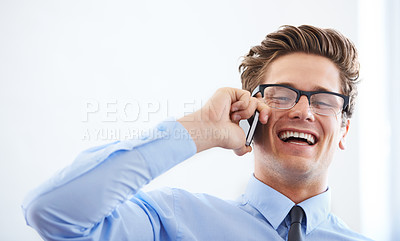 Buy stock photo An excited young businessman on his smartphone alongside copyspace