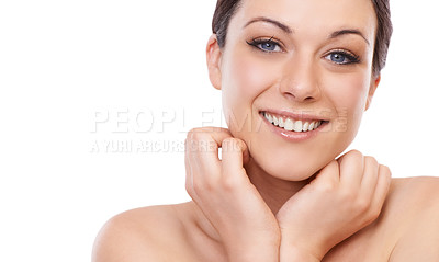 Buy stock photo A beautiful young woman smiling at the camera while holding her face in her hands - copyspace