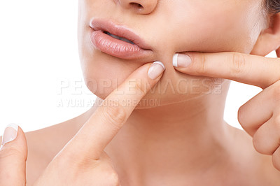 Buy stock photo A cropped image of a woman squeezing a pimple