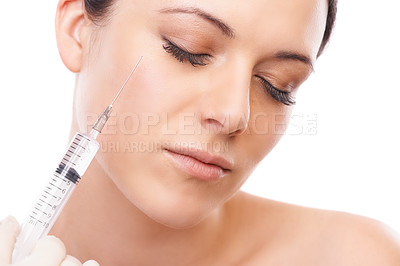 Buy stock photo A lovely young woman getting a botox injection in her face