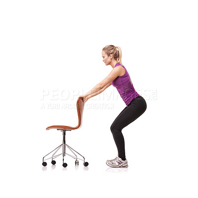 Buy stock photo A beautiful young woman wearing gym clothes and crouching down while using a chair for support against a white background