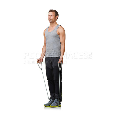 Buy stock photo A fit young man working out with a resistance band while isolated on a white background