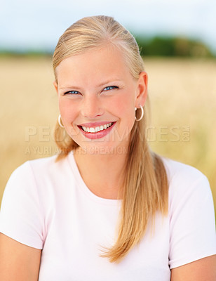Buy stock photo Beautiful young woman standing at a field