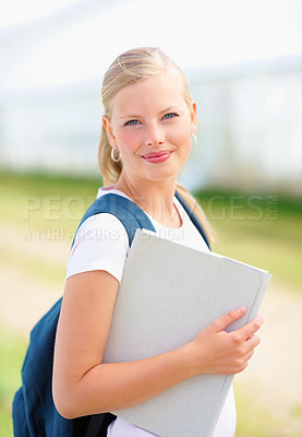 Buy stock photo Portrait of a young female student with a folder smiling outdoor