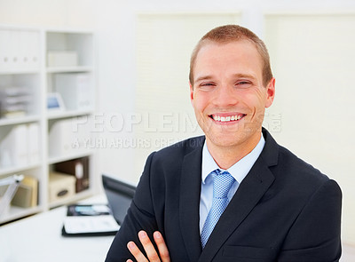 Buy stock photo Portrait of a handsome young business man smiling at work