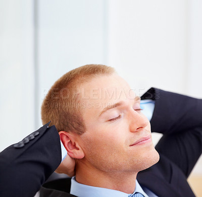 Buy stock photo Closeup portrait of a young business executive feeling good and relaxing in the office