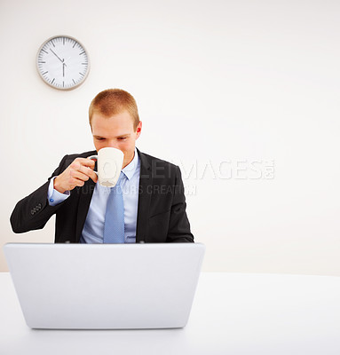 Buy stock photo Portrait of a young business executive drinking coffee while looking at the computer